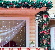Window decorated in Christmas style by vladromensky