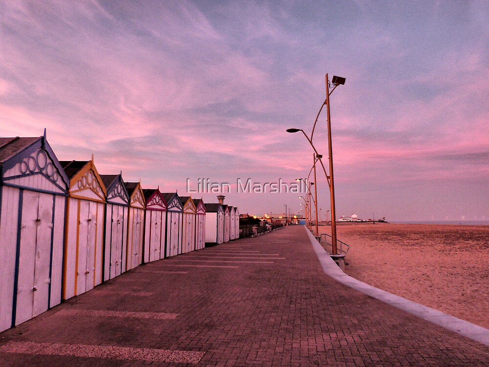 Beach huts at sunset. by Lilian Marshall
