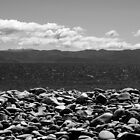 Boulders, sea, mountains, sky by Duncan Cunningham