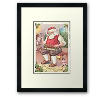 A Vintage Merry Christmas Santa Claus in his Workshop Framed Print