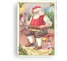 A Vintage Merry Christmas Santa Claus in his Workshop Canvas Print
