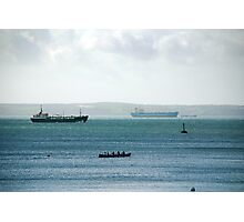 Silhouette of Gig boat racers with large cargo ships in background, St Mawes, Cornwall Photographic Print