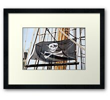 Skull and crossbones pirate flag on tall ship, Plymouth, Devon, UK Framed Print