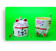 Playing golf on cat cups Canvas Print