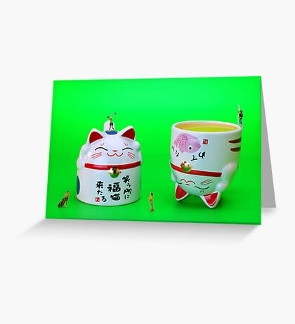 Playing golf on cat cups Greeting Card