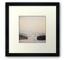 Snow covers the land Framed Print