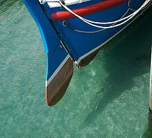 Rudder section of the vintage Looe Lifeboat in azure blue sea, Cornwall, UK by silverportpics