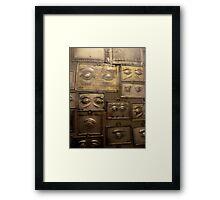 Wall of votives in Czestochowa, Poland Framed Print