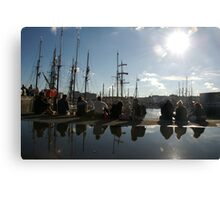 People relaxing on the harbourside with tall ships masts behind, Brest 2008 maritime festival, France Canvas Print