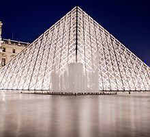 pyramid of the Louvre at night in Paris, France  by hpostant