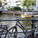 Bike and boat in Amsterdam  by hpostant