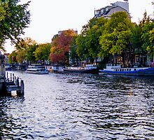 Canal in autumn in Amsterdam, Netherlands  by hpostant