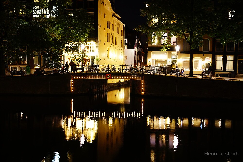 Reflections in the canal at night in Amsterdam, Netherlands  by hpostant