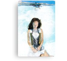 A young woman in white dress floats underwater  Canvas Print