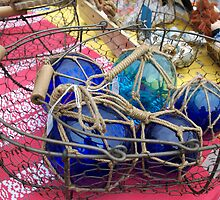 Blue glass fishing floats, Brest 2008 maritime festival, France by silverportpics