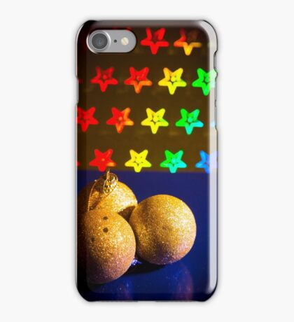 Three yellow Christmas balls on stars background of bright colors iPhone Case/Skin
