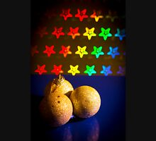 Three yellow Christmas balls on stars background of bright colors Unisex T-Shirt