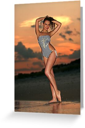 Beautiful brunette posing sexy at the beach during golden sunset time by Anton Oparin