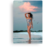 Beautiful brunette posing sexy at the tropical beach during sunset time Canvas Print