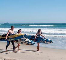three surfers by Anne Scantlebury