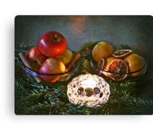 Christmas:a candle, fir branches spices and fruits Canvas Print