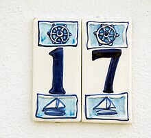 Nautical number seventeen house sign with ships wheel and yachts, Le Conquet, Brittany, France by silverportpics
