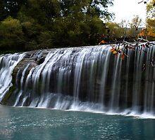 majestic waterfall by thehylian