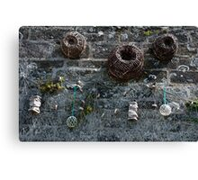 Fishing baskets, glass floats and nets, Brittany, France Canvas Print