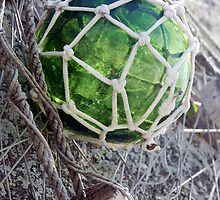 Traditional green glass fishing float and net, Brittany, France by silverportpics