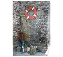 Lifebuoy, boat oar and fishing nets outside house Le Conquet, Brittany, France Poster
