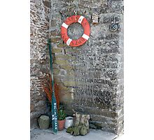 Lifebuoy, boat oar and fishing nets outside house Le Conquet, Brittany, France Photographic Print