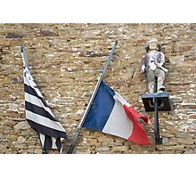 Seafaring figure with Breton and French flags, Brittany, France Photographic Print