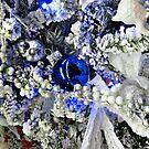 A Beautiful Blue Christmas Ball On A Snowy Tree by Jane Neill-Hancock