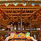 Pleasure - Seaside carousel Brighton UK by enphoto