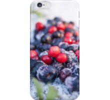 Frozen red lingonberries, vaccinium vitis-idaea and blue blueberries, vaccinium corymbosum iPhone Case/Skin