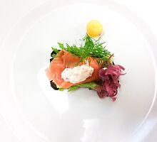 White plate with a salmon bread by Daniel Rönneberg