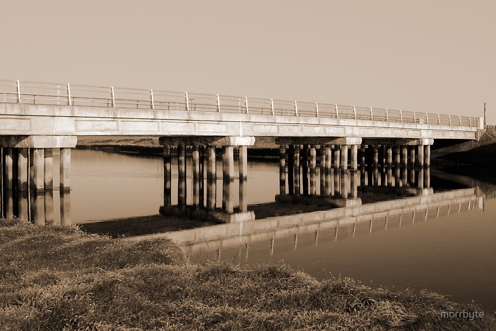 irish road bridge over cold river in sepia by morrbyte