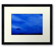 Shining through the storm clouds Framed Print