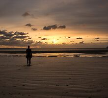 Anthony Gormley Iron Man On Crosby Beach At Sunset by Paul Madden