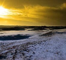 red sky at sundown on a snow covered links golf course by morrbyte