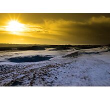 red sky at sundown on a snow covered links golf course Photographic Print