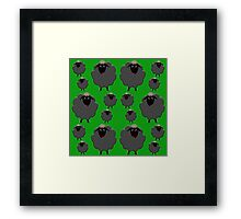 A whole flock of black sheep on green Framed Print
