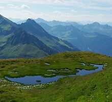 Mountain pond with a view near Furkajoch, Austria by Claudio Del Luongo