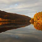 Autumn Reflections on Loch Eilt. by John Cameron