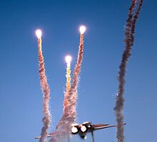 Israeli Air force F-15I Fighter in flight Emitting anti-missile flares by PhotoStock-Isra