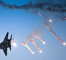 IAF F-15I Fighter in flight Emitting anti-missile flares by PhotoStock-Isra