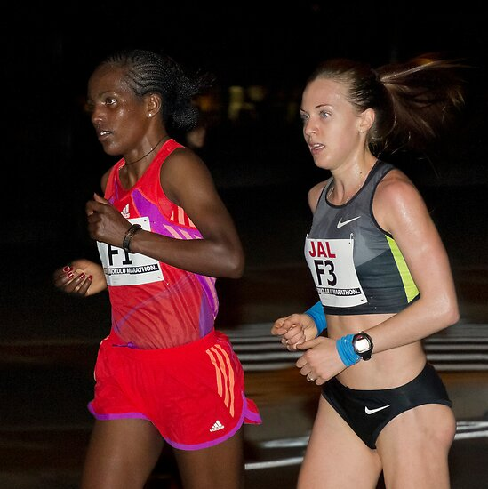 Valentina Galimova Of Russia The 2012 Women's Honolulu Marathon Winner and Woynishet Girma of Ethiopia.  by Alex Preiss