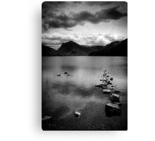 Rocks in a row in monochrome, Lake Buttermere, Lake District Canvas Print