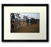 Bikes on a Fence, Near a Building, Beside a Road Framed Print
