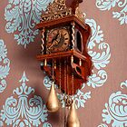 Antique Dutch Clock on a Wall by Artur Bogacki